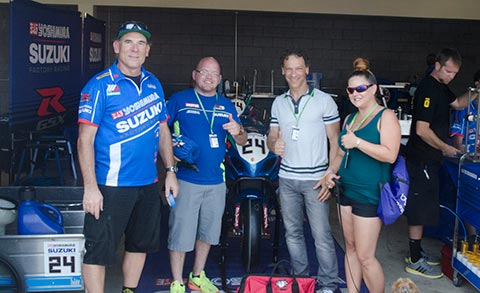 Dan, his fiancé and their pooch, Bradl, pose with Rich Doan of Yoshimura and David Podolsky of Chicken Hawk Racing.